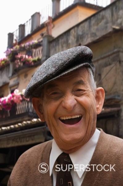 Stock Photo: 1589R-132504 Senior Hispanic man in cap, smiling