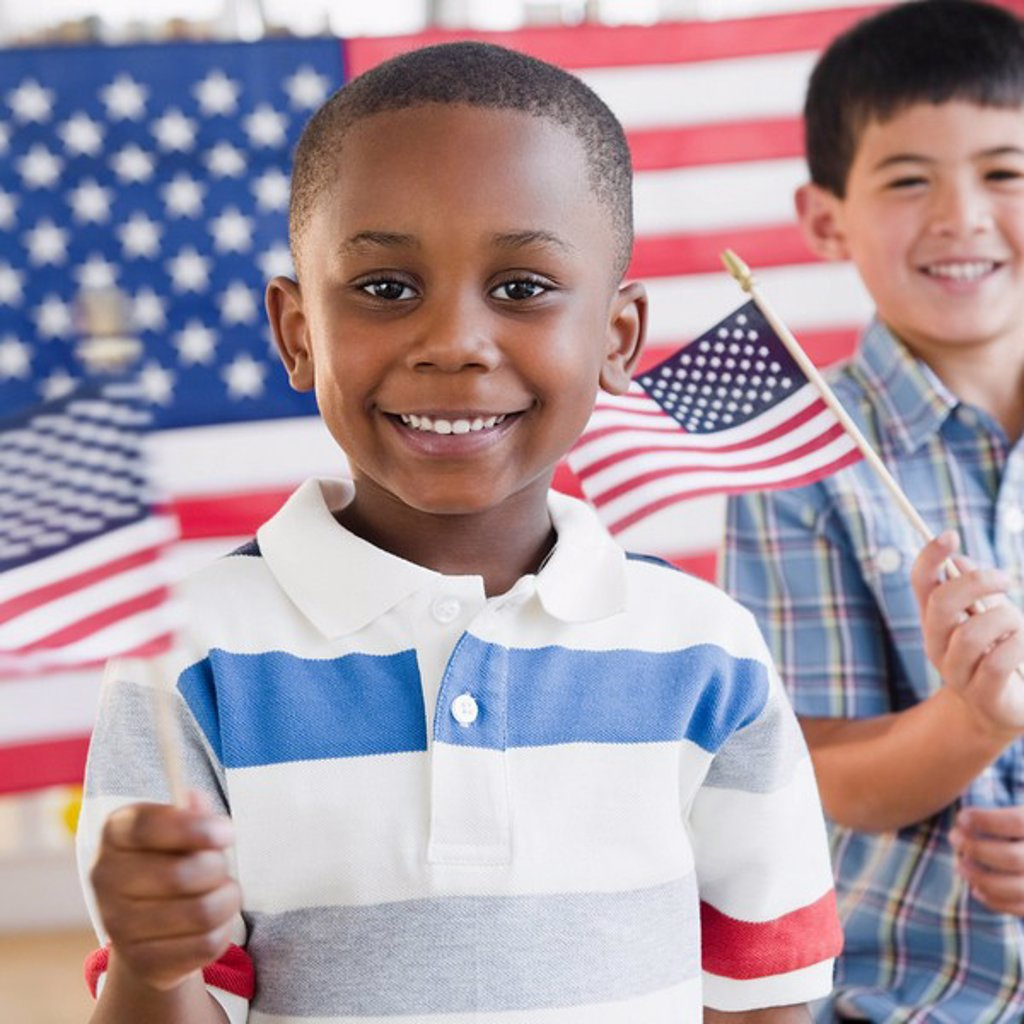Stock Photo: 1589R-133193 Boys holding small American flags