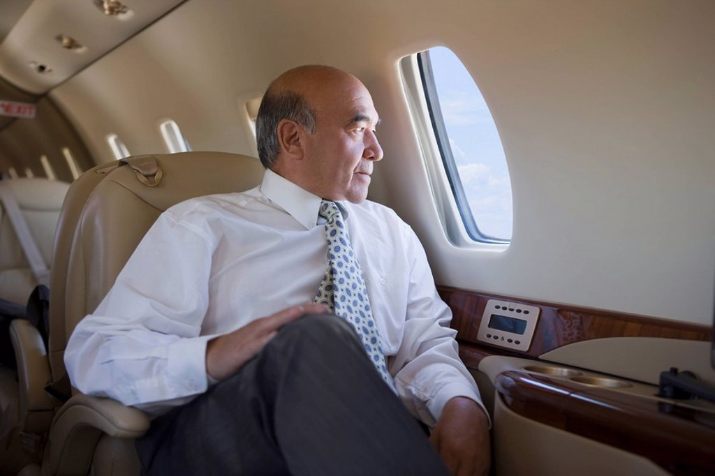 Stock Photo: 1589R-133638 Hispanic businessman on private jet