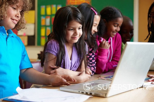 Stock Photo: 1589R-134044 Students using laptop in classroom