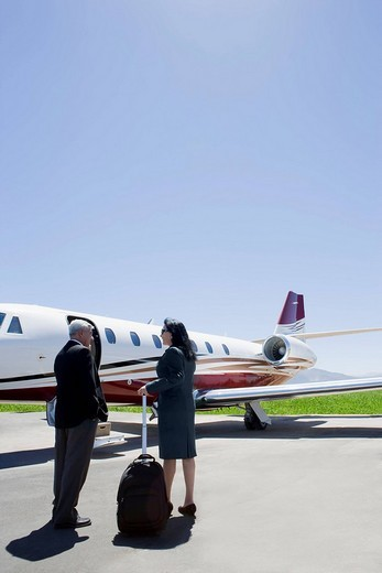 Stock Photo: 1589R-134058 Business people boarding private jet