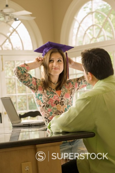 Stock Photo: 1589R-134258 Father admiring daughter´s graduation cap