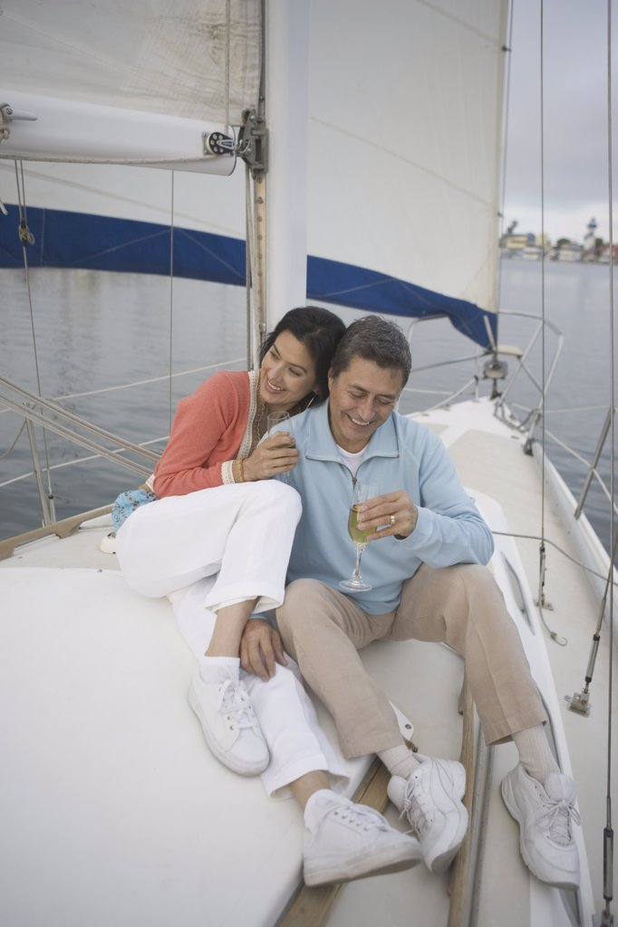 Stock Photo: 1589R-13426 Couple enjoying their sailboat