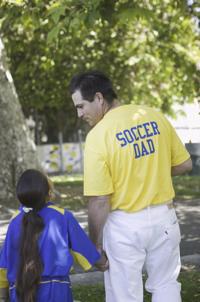 Soccer dad with his daughter : Stock Photo