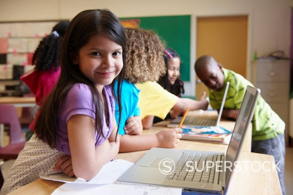Students using laptop in classroom : Stock Photo