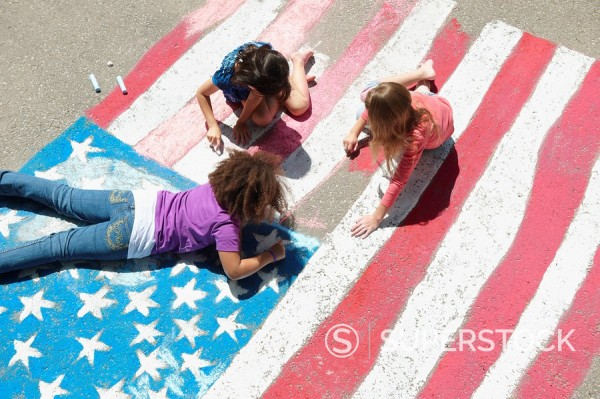 Stock Photo: 1589R-134606 Girls with chalk coloring American flag on sidewalk