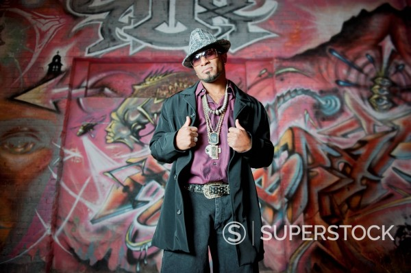 Stock Photo: 1589R-134715 Hip African American man standing near graffiti
