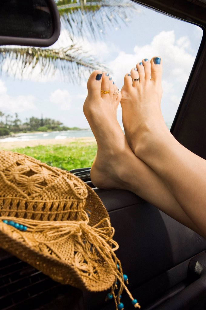 Woman with feet up in car : Stock Photo