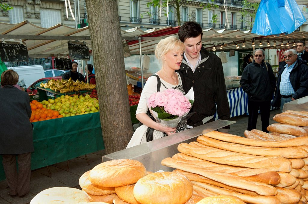 Stock Photo: 1589R-134981 Caucasian couple shopping for bread at market