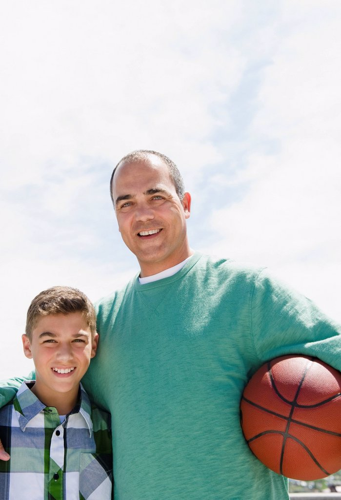 Stock Photo: 1589R-135356 Hispanic father and son with basketball
