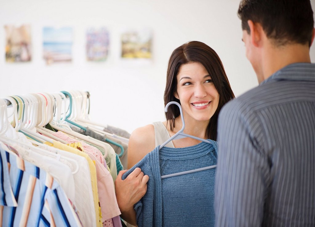 Stock Photo: 1589R-135367 Smiling couple shopping for clothing together