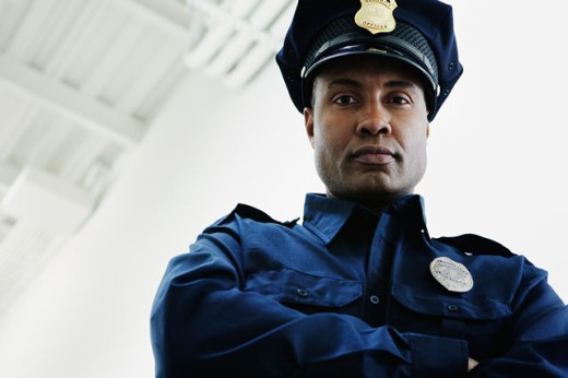Stock Photo: 1589R-13624 Low angle view of security guard