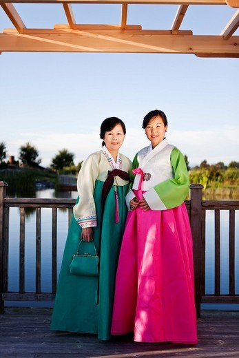 Korean mother and daughter in traditional clothing : Stock Photo