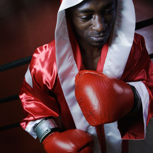 Male boxer in robe ready to fight : Stock Photo