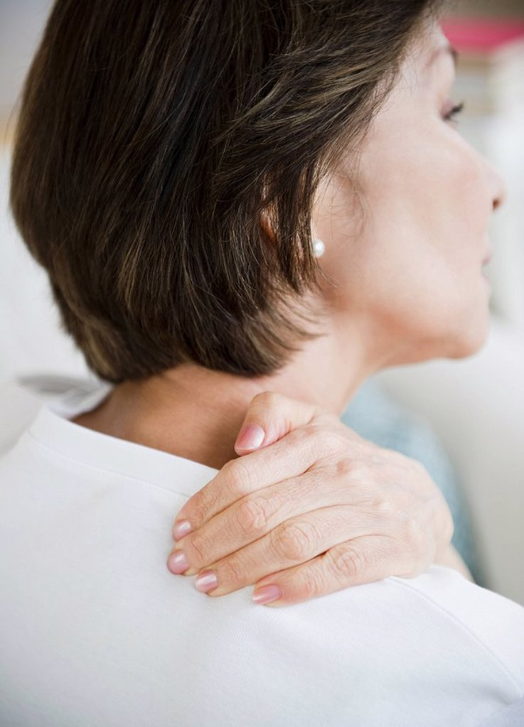Japanese woman rubbing neck and shoulders : Stock Photo