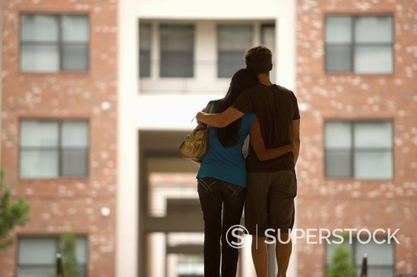 Stock Photo: 1589R-137897 Rear view of couple hugging outdoors