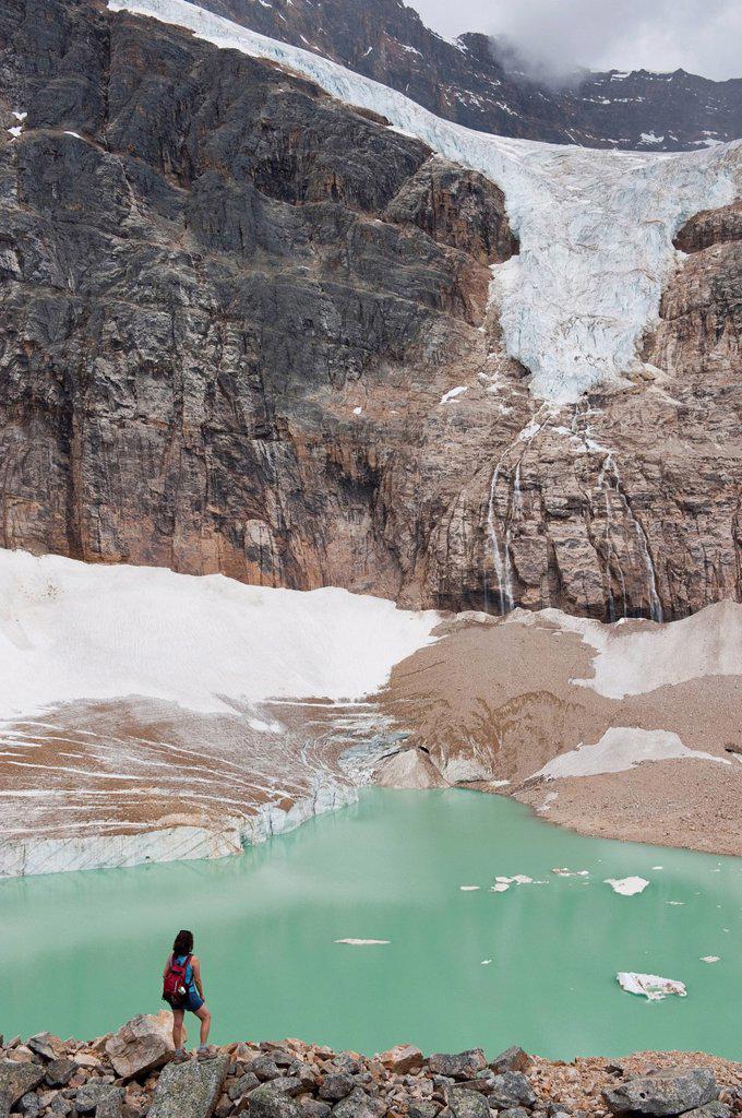 Hispanic woman hiking hear glacial lake : Stock Photo