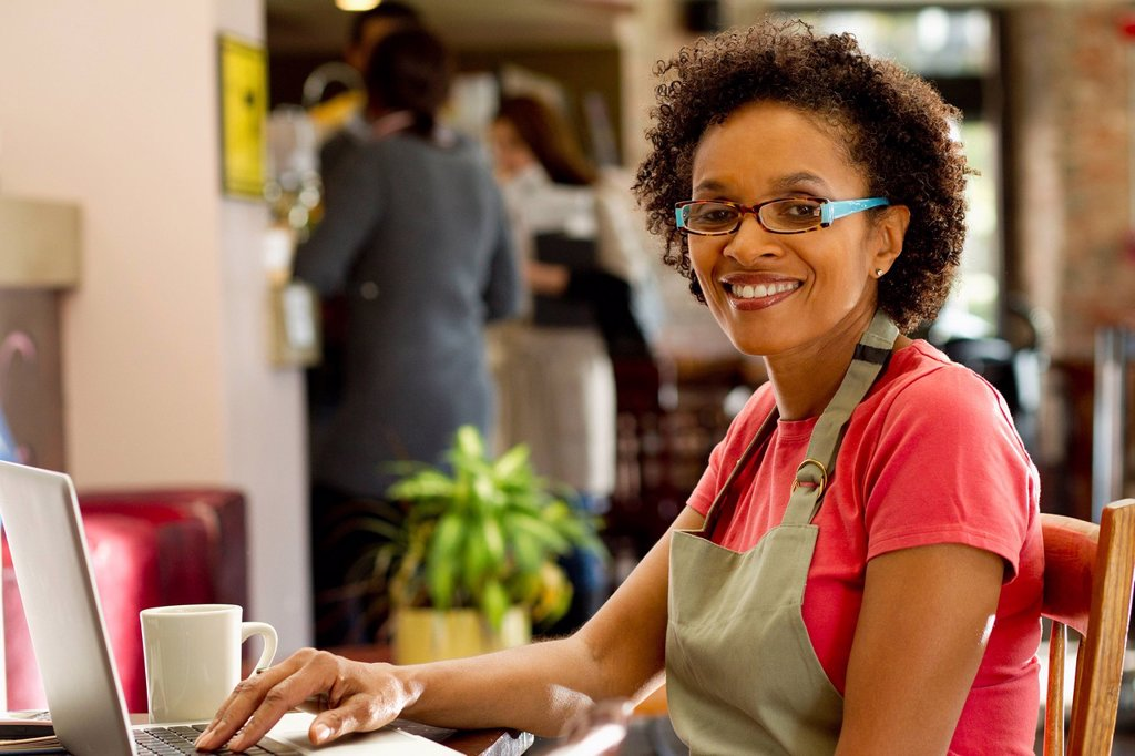 Stock Photo: 1589R-138364 African American small business owner in shop