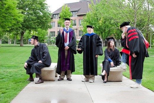 Professors and students waiting for graduation : Stock Photo