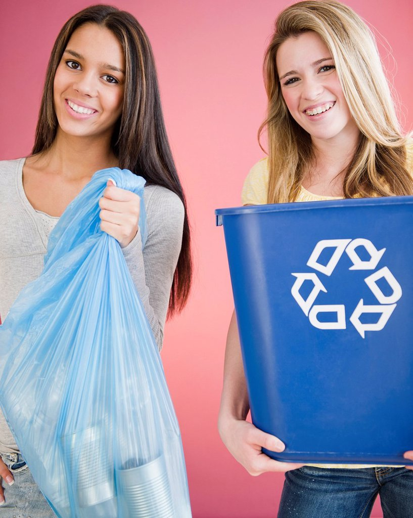 Stock Photo: 1589R-138939 Teenage girls carrying recycling