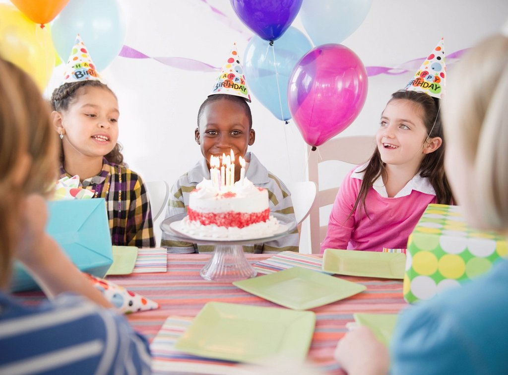 Happy boy at birthday party with birthday cake : Stock Photo