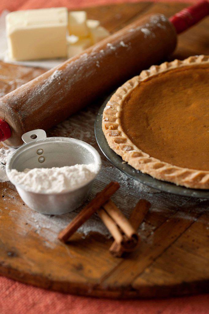 Baking ingredients and homemade pumpkin pie : Stock Photo