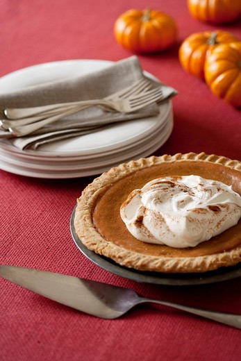 Stock Photo: 1589R-139142 Plates, forks and pumpkin pie