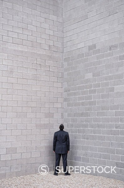 Stock Photo: 1589R-139583 Hispanic businessman standing in corner