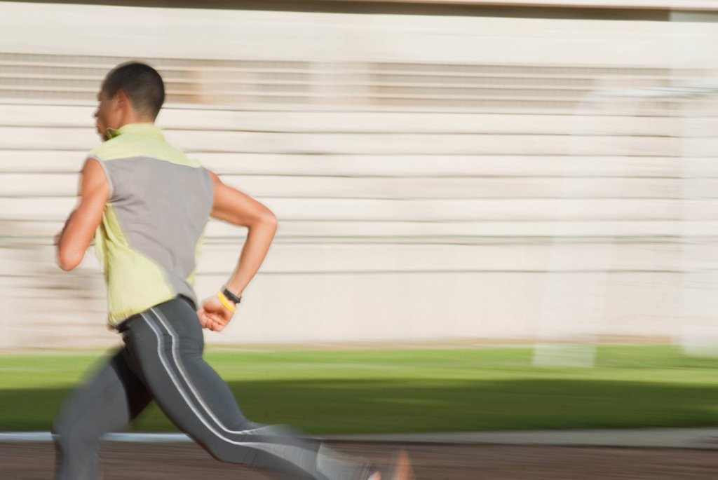 Hispanic man running : Stock Photo