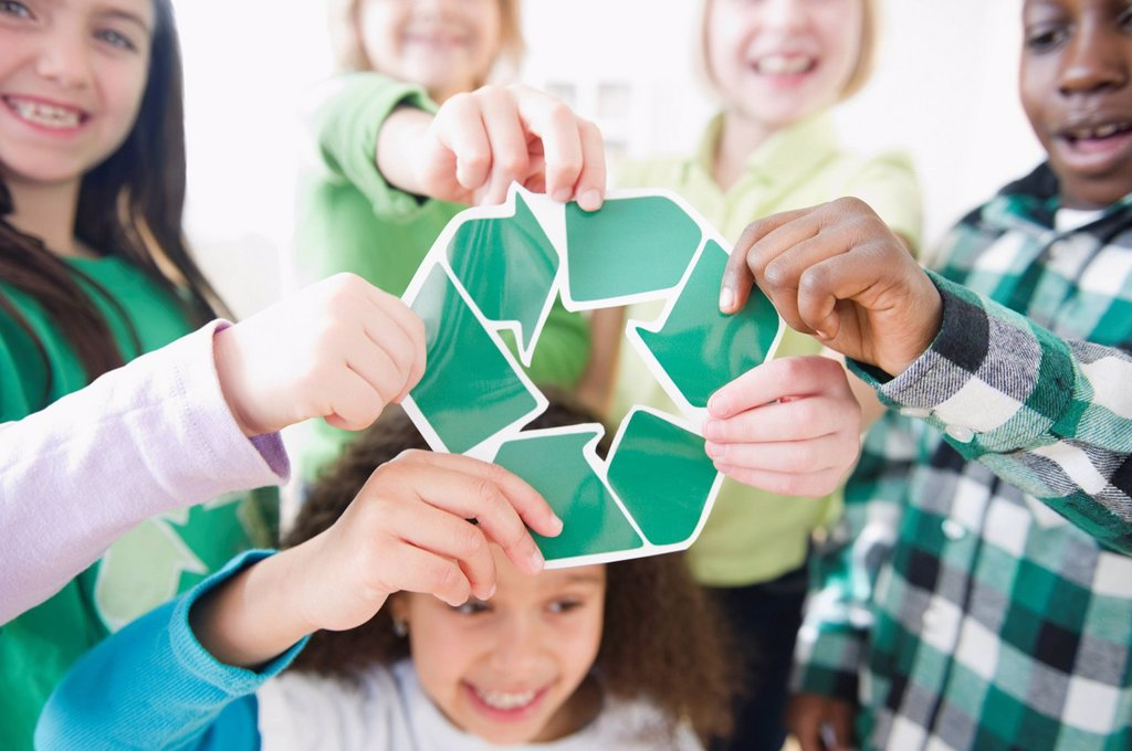 Stock Photo: 1589R-140027 Children holding green recycling symbol