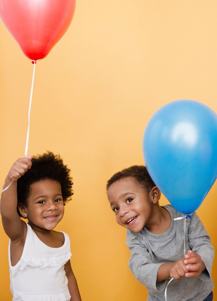 Black children holding helium balloons : Stock Photo