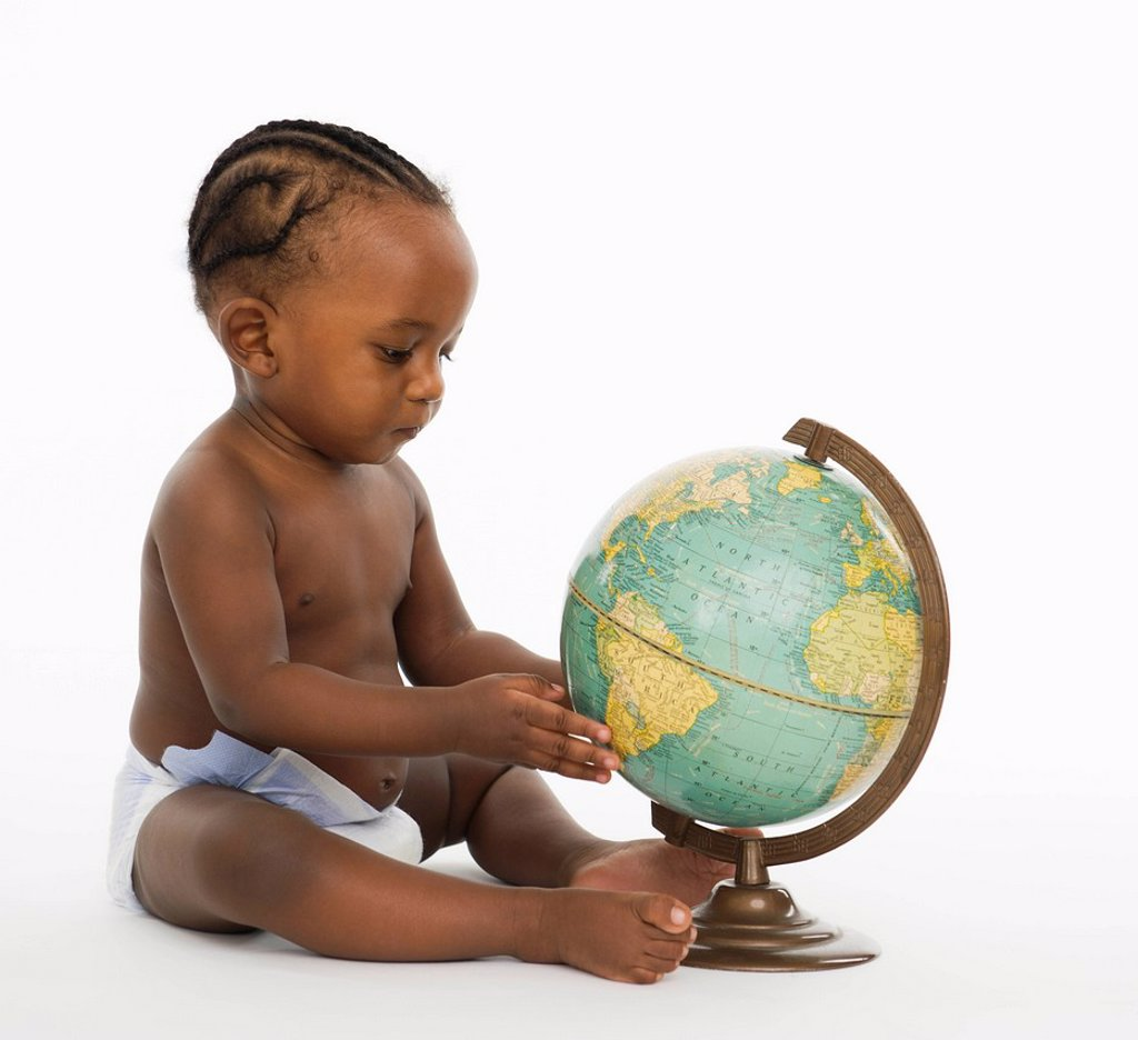 Stock Photo: 1589R-140143 African American baby looking at globe