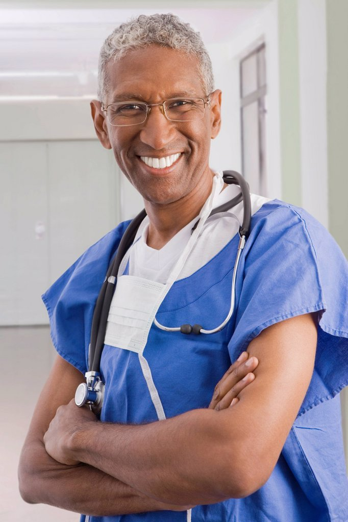 Stock Photo: 1589R-140295 Smiling mixed race surgeon with arms crossed