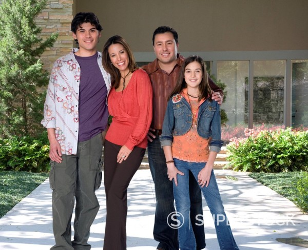 Stock Photo: 1589R-140846 Family standing on walkway in front of house