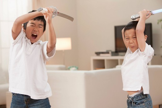 Korean brothers playing with swords : Stock Photo
