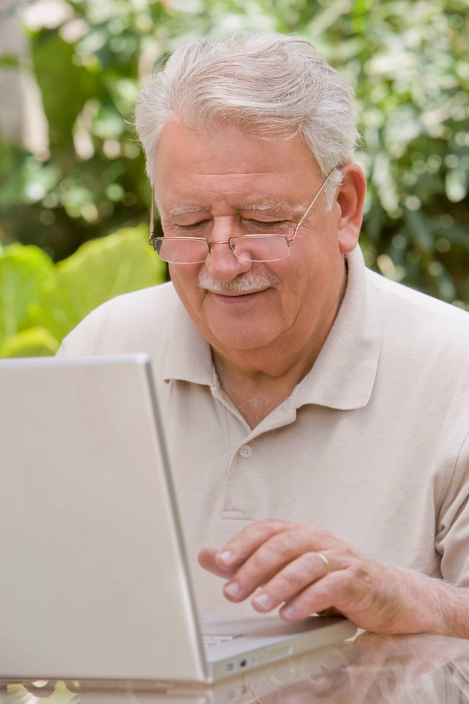 Stock Photo: 1589R-141329 Senior Chilean man typing on laptop