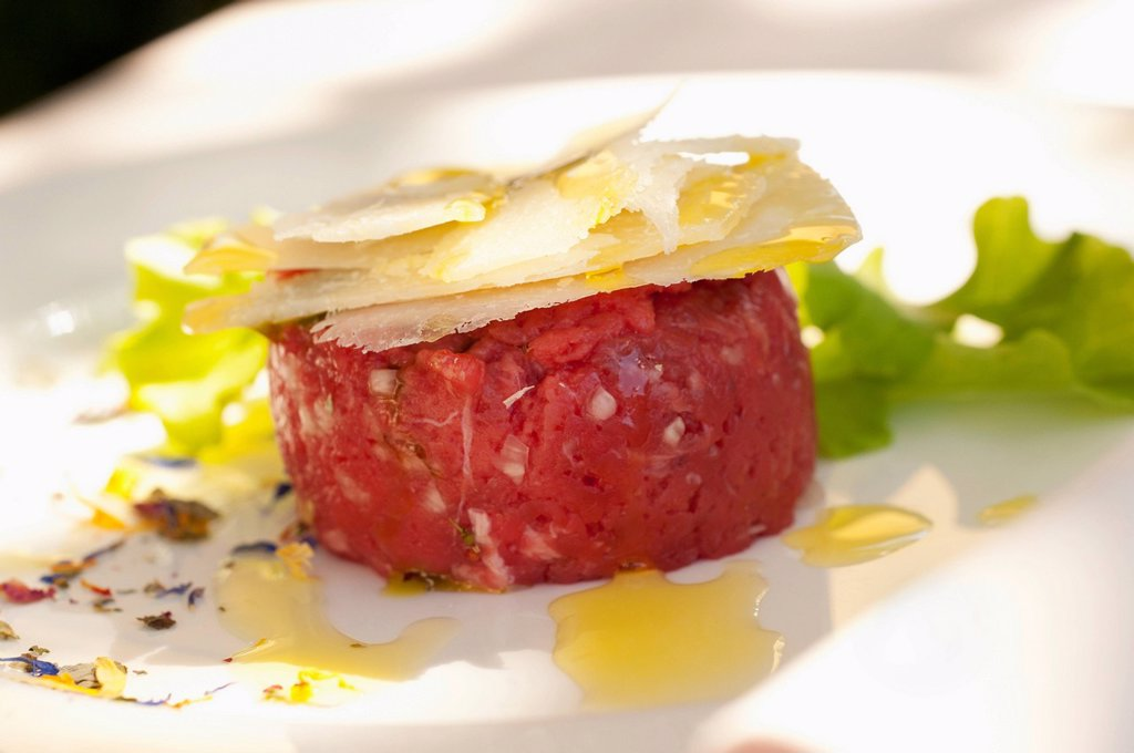 Stock Photo: 1589R-141374 Parmesan cheese atop steak tartare
