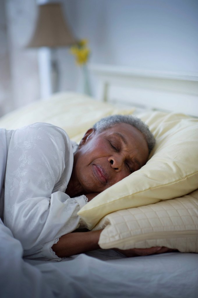 Stock Photo: 1589R-141650 Black woman sleeping in bed