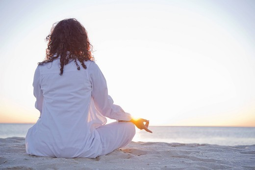 Stock Photo: 1589R-143822 Mixed race woman practicing yoga on beach