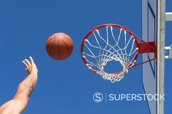 Mixed race man playing basketball : Stock Photo