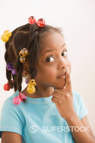 Stock Photo: 1589R-144106 Black girl making shhh gesture