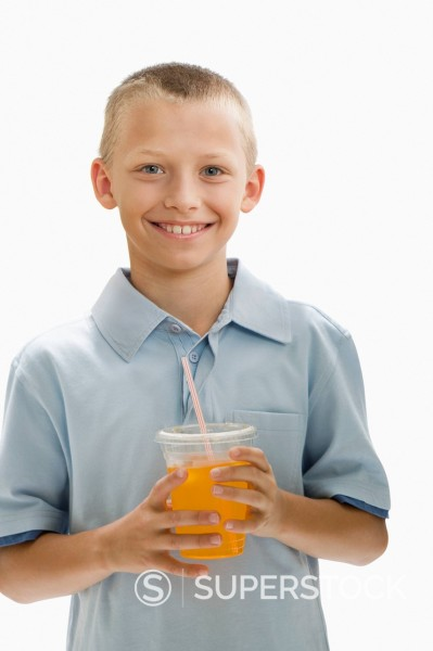 Stock Photo: 1589R-144150 Caucasian boy drinking orange juice