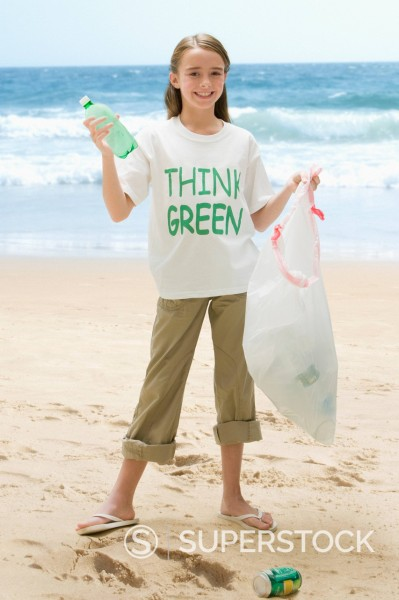 Stock Photo: 1589R-144154 Caucasian girl picking up litter from beach