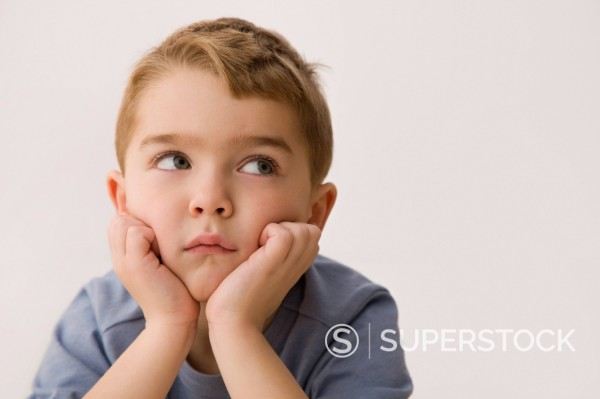 Stock Photo: 1589R-144290 Bored Caucasian boy looking up