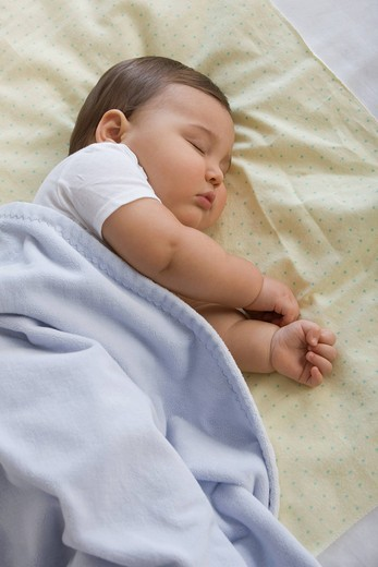 Mixed race baby boy sleeping : Stock Photo