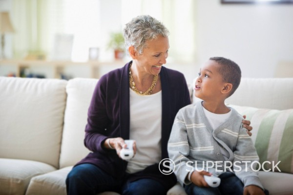 Stock Photo: 1589R-144595 Grandmother and grandson playing video game