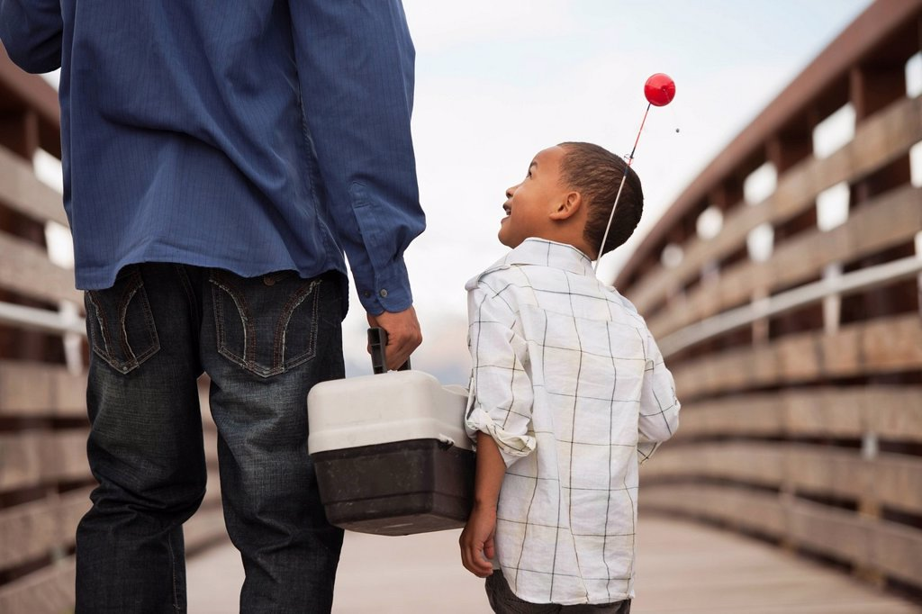Father and son going fishing together : Stock Photo