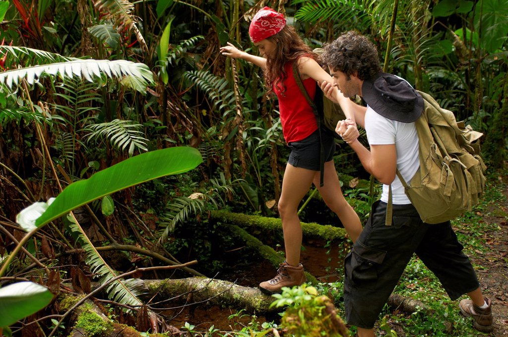 Stock Photo: 1589R-145217 Hispanic couple hiking together in forest