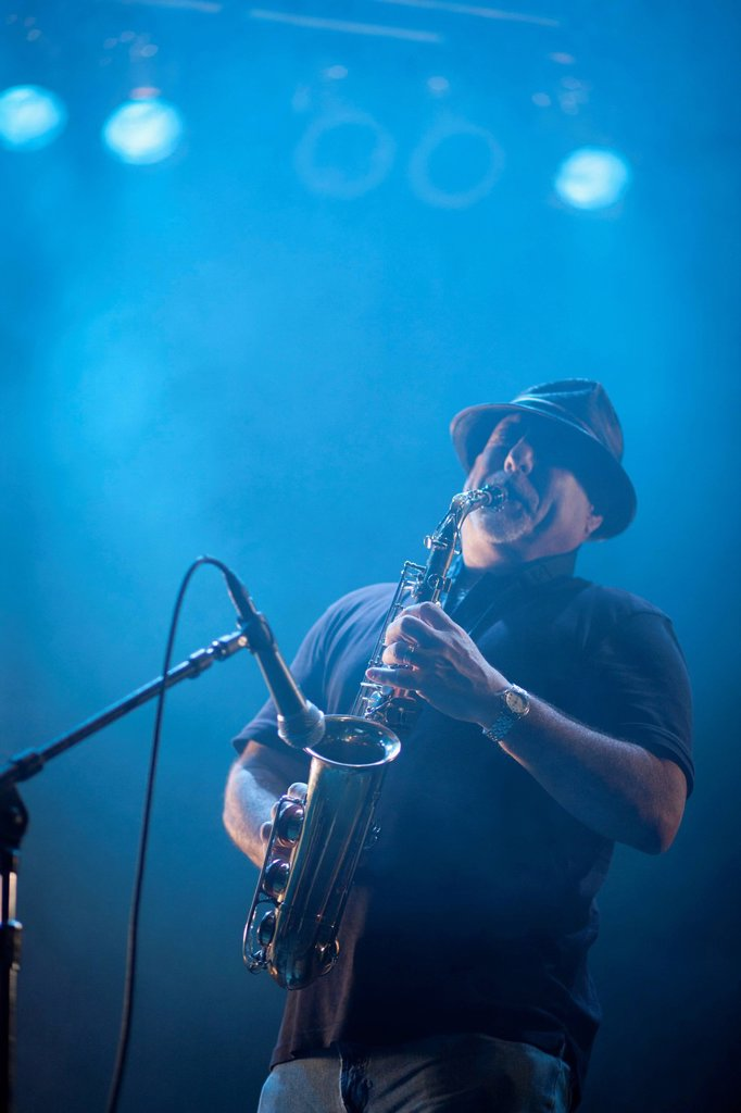 Stock Photo: 1589R-145546 Black musician playing saxophone on stage
