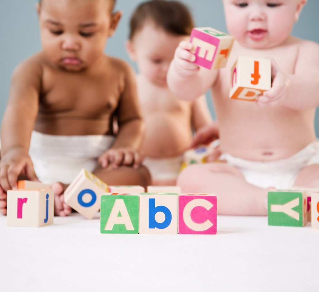 Stock Photo: 1589R-145574 Babies playing with alphabet blocks